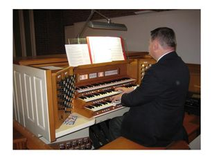 Arnold Ostlund Jr. Playing the organ at West Center Church
